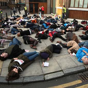 Students from around the UK lie on the ground during an Amnesty International 'die-in' protest