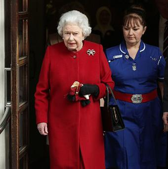 The Queen leaving King Edward VII's hospital in London, where she spent a night after having symptoms of gastroenteritis