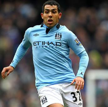 Manchester City footballer Carlos Tevez has been arrested over an alleged driving offence, say police sources
