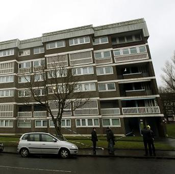 The scene on St Andrew's Drive in Glasgow after a four-year-old boy died after falling from the window of a block of flats