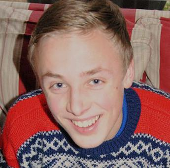 The family of Charlie Booth, 16, found dead in his home in Cobham, described him as a one-in-a-million son. (PA/Kent Police)