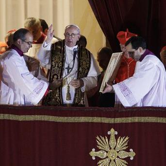 Pope Francis blesses the crowd from the central balcony of St Peter's Basilica at the Vatican (AP)