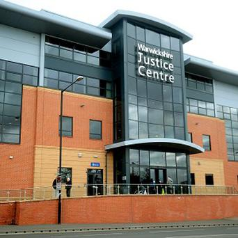 More than 60 people are being held by police at the Warwickshire Justice Centre in Nuneaton after disorder in the town centre