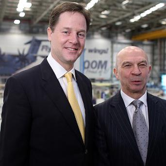 Deputy Prime Minister Nick Clegg and Tom Williams, head of Airbus UK pose for photographs as he visits the Airbus site at Filton, Bristol