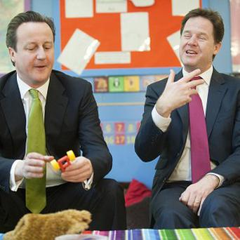 Prime Minister David Cameron and Deputy Prime Minister Nick Clegg at Wandsworth Day Nursery in south London
