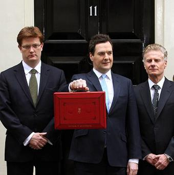 The Chancellor and his Treasury team outside 11 Downing Street