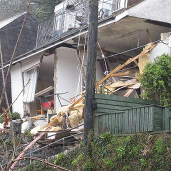 The ''Veronica' flats on Sandplace Road, East Looe, Cornwall, collapsed following torrential rain