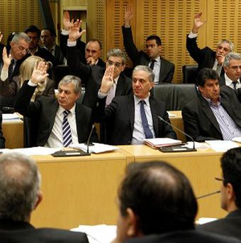 Cypriot politicians vote on key bills aimed at securing a broader bailout package (AP/Petros Karadjias)