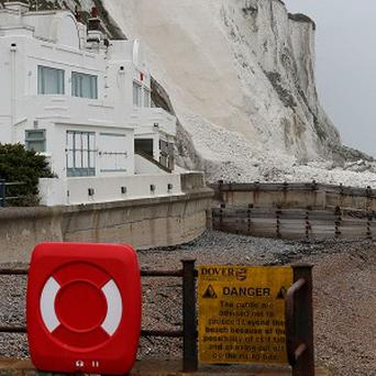 The scene in St Margaret's Bay after tonnes of chalk from the world famous White Cliffs of Dover collapsed into the English Channel (PA)