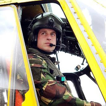 The Duke of Cambridge at the controls of a Sea King helicopter during a training exercise