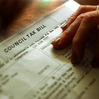 Communities Secretary Eric Pickles said council tax has fallen almost 10 per cent in real terms under the Coalition