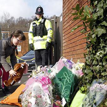 Flowers and tributes are laid near the scene where Jade Anderson was found dead, believed to have been killed by a pack of dogs