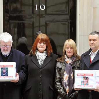 Edward Thornber's parents Adrian and Ann, left, deliver the petition alongside Joe Lawton's mother and father Jane and Nick