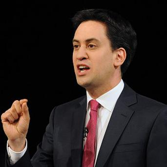 Labour leader Ed Miliband has claimed families are 891 per year worse off under coalition tax and benefit schemes