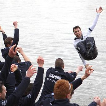 Oxford's cox Oskar Zorrilla is thrown into the river by his teammates as they celebrate winning the 159th Boat Race