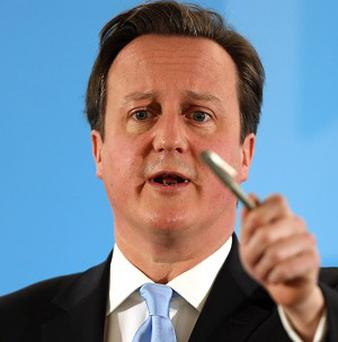 Prime Minister David Cameron has welcomed a landmark deal regulating the international arms trade