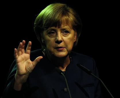 German Chancellor Angela Merkel gestures as she gives a speech at the German sustainable development congress in Berlin, May 13, 2013. REUTERS/Fabrizio Bensch (GERMANY - Tags: POLITICS ENVIRONMENT HEADSHOT)