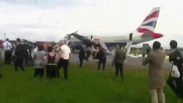The British Airways passenger jet after it made an emergency landing at Heathrow Airport west of London yesterday.