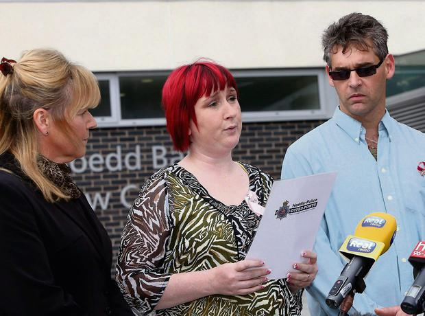 Coral (centre) and Paul Jones, the parents of April Jones give a statement outside Mold Crown Court after Mark Bridger was given a whole life sentence for the abduction and murder of the schoolgirl. PRESS ASSOCIATION Photo. Picture date: Thursday May 30, 2013. See PA story COURTS April. Photo credit should read: Peter Byrne/PA Wire