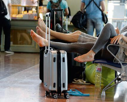 Delayed passengers put their feet up at Nice airport