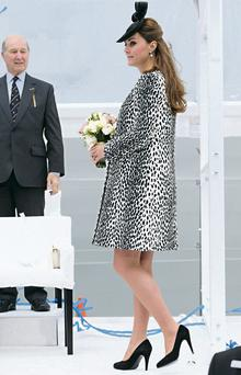 Kate Middleton hides her bump under a Hobbs coat