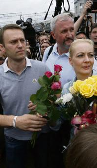 FREE: Alexei Navalny, who was sent to then freed from a detention centre, with his wife Yulia