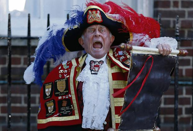 Town crier Tony Appleton announces the birth of the royal baby outside St Mary's Hospital in London