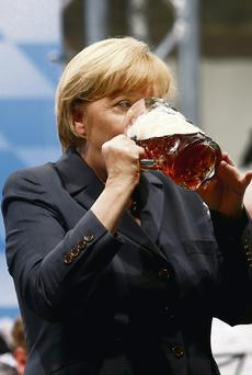 Angela Merkel downing a beer during an electoral rally in the town of Dachau, where the notorious Nazi concentration camp is located
