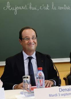 Francois Hollande pictured pulling a face in school yesterday