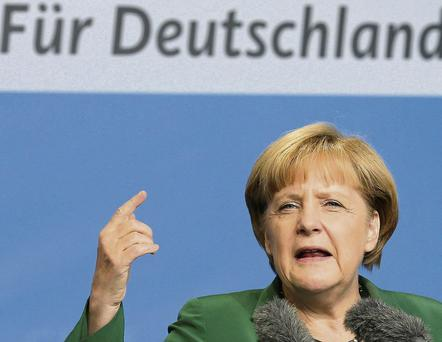 Chancellor Merkel gestures during her speech at an election campaign event in Schwerin