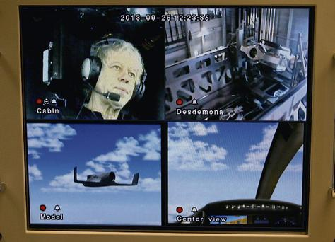 Bob Geldof gets strapped into the seat of the Desdemona flight simulator in Soesterberg, Netherlands