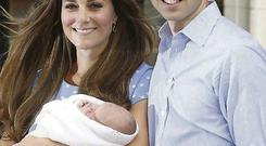 Prince William and Kate Middleton with Prince George after his birth.