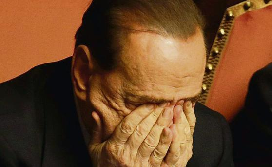 Silvio Berlusconi rubs his eyes after delivering his speech at the Senate yesterday