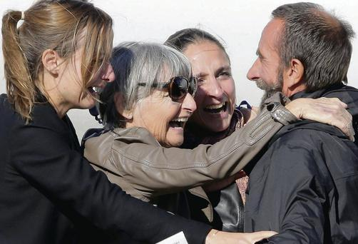 Former French hostage Daniel Larribe, right, is welcomed by relatives at Villacoublay military airport, near Paris, yesterday