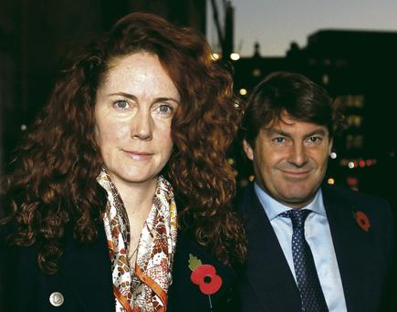 Rebekah Brooks, with husband and co-accused Charlie, outside the Old Bailey, London, yesterday