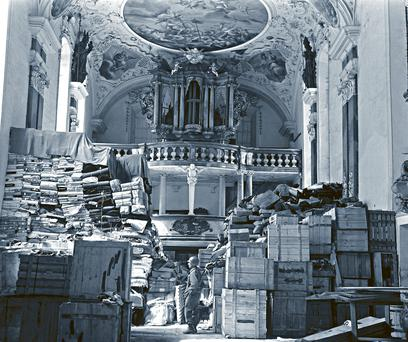 US soldier views art stolen by the Nazi regime and stored in a church at Ellingen, Germany, in April 1945