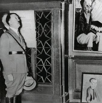Adolf Hitler visits the so-called chamber of horrors exhibition in Dresden in 1935, which was a forerunner to the Degenerate Art exhibition