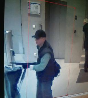 Images taken from surveillance footage showing a suspect gunman who fired shots at the office of 'Liberation' newspaper, seriously injuring a photographer's assistant before fleeing. Reuters
