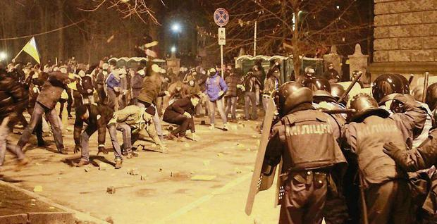 Protesters throw stones at police during the rally in Kiev.