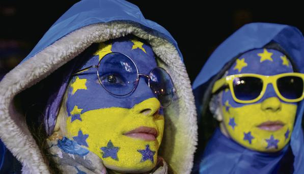People supporting EU integration attend a rally at Independence Square in Kiev.
