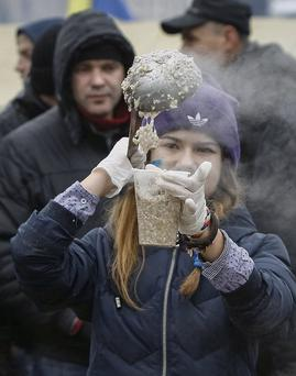 A protester cooks free meals at a rally in Kiev. Gleb Garanich