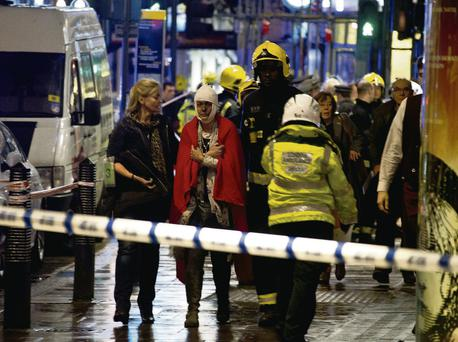 Emergency services attending the scene at the Apollo Theatre in Shaftesbury Avenue, central London