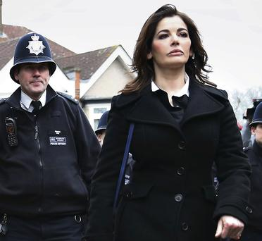 Nigella Lawson flanked by police as she arrived at Isleworth Crown Court in London earlier this month. Peter Macdiarmid/Getty