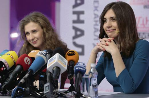 Members of the Russian punk band Pussy Riot Nadezhda Tolokonnikova, right, and Maria Maria Alyokhina giving their first news conference in Moscow, Russia, after their release from prison after nearly two years. AP Photo/Ivan Sekretarev