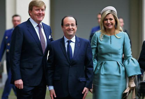 President Francois Hollande (centre) with Queen Maxima and King Willem-Alexander of The Netherlands