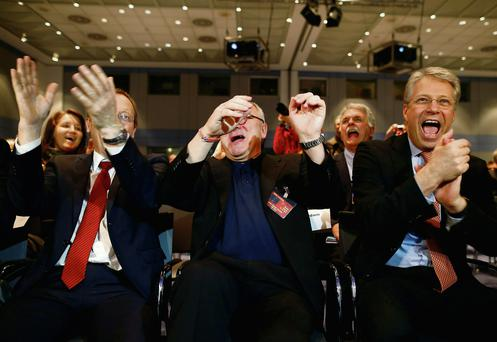 Johann-Dietrich Woerner, Jean-Jacques Dordain and Thomas Reiter react after ESA's satellite Rosetta, inset, resent a signal to ESOC in Darmstadt, Germany