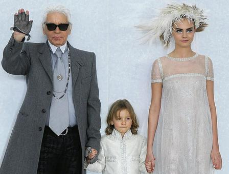 Designer Karl Lagerfeld, his godson Hudson Kroenig and model Cara Delevingne walk the runway during the Chanel show as part of Paris Fashion Week. Pascal Le Segretain