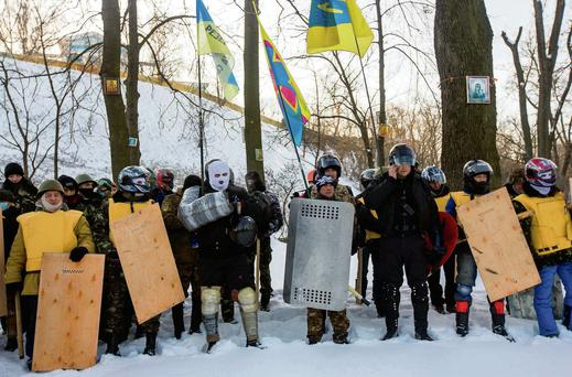 Anti-government groups at religious service in Kiev. President Yanukovych has taken a number of measures to try to appease the protesters. Photo: Thomas Peter