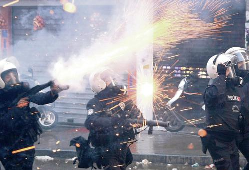 Police used water cannon and tear gas on protesters. ULAS YUNUS TOSUN/EPA