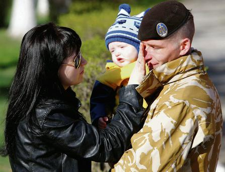 A Ukrainian marine speaks with his wife and son before departing Crimea outside a Ukrainian military base in Feodosia.
